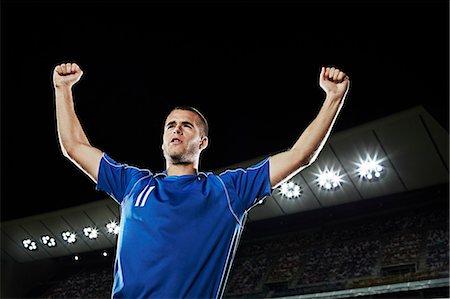footballeur - Soccer player cheering in stadium Stock Photo - Premium Royalty-Free, Code: 6113-07310562