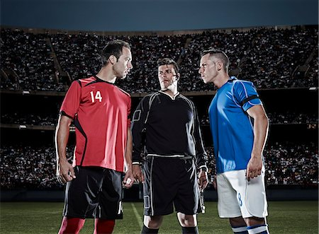 soccer player (male) - Soccer players facing each other on field Stock Photo - Premium Royalty-Free, Code: 6113-07310564