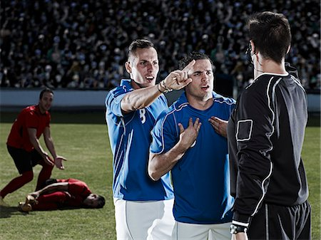 soccer player (male) - Soccer players arguing with referee on field Stock Photo - Premium Royalty-Free, Code: 6113-07310569
