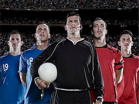 football team - Soccer teams and referee standing in stadium Stock Photo - Premium Royalty-Free, Code: 6113-07310572