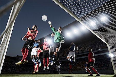Soccer players defending goal Stock Photo - Premium Royalty-Free, Code: 6113-07310576