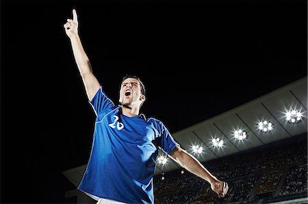 footballeur - Soccer player cheering in stadium Stock Photo - Premium Royalty-Free, Code: 6113-07310579