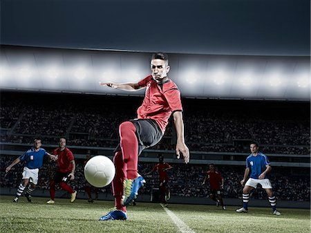 soccer player (male) - Soccer player kicking ball on field Stock Photo - Premium Royalty-Free, Code: 6113-07310588