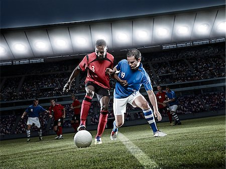 footballeur - Soccer players chasing ball on field Stock Photo - Premium Royalty-Free, Code: 6113-07310537