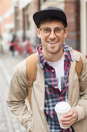 Man with cup of coffee on city street Stock Photo - Premium Royalty-Free, Code: 6113-07542440