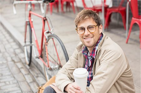 Man drinking coffee on city street Stock Photo - Premium Royalty-Free, Code: 6113-07542476