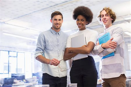 Business people smiling in office Stock Photo - Premium Royalty-Free, Code: 6113-07542433