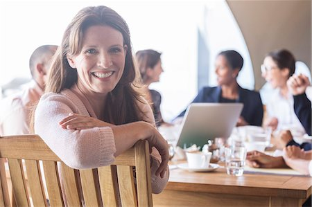 Businesswoman smiling in meeting Stock Photo - Premium Royalty-Free, Code: 6113-07542599