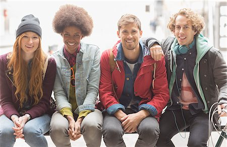 fashion - Friends smiling on urban bench Stock Photo - Premium Royalty-Free, Code: 6113-07542538