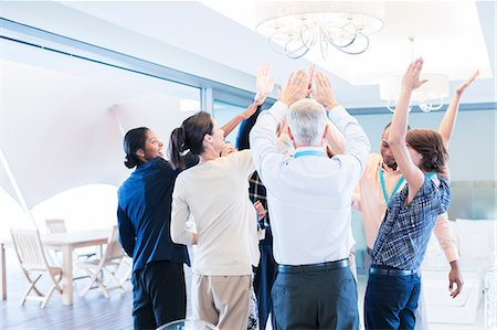 Business people cheering in office Stock Photo - Premium Royalty-Free, Code: 6113-07542641