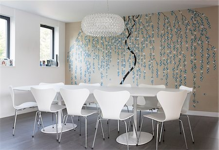 Wall art and chandelier in modern dining room Stock Photo - Premium Royalty-Free, Code: 6113-07542650