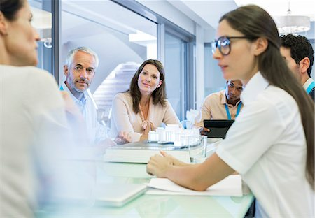 partnership - Business people talking in meeting Stock Photo - Premium Royalty-Free, Code: 6113-07542614