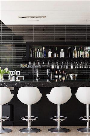 Empty stools at bar Stock Photo - Premium Royalty-Free, Code: 6113-07542703