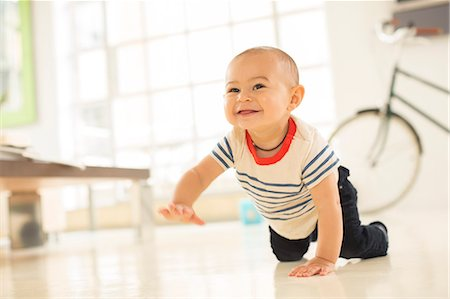 Baby boy crawling on living room floor Stock Photo - Premium Royalty-Free, Code: 6113-07542847