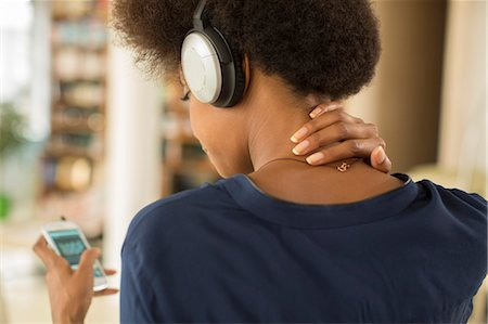 Woman listening to headphones Stock Photo - Premium Royalty-Free, Code: 6113-07542850