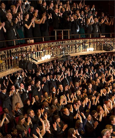Audience applauding in theater Stock Photo - Premium Royalty-Free, Code: 6113-07542948