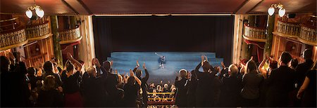 Audience applauding in theater Stock Photo - Premium Royalty-Free, Code: 6113-07542952