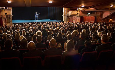 Audience watching performer on stage in theater Stock Photo - Premium Royalty-Free, Code: 6113-07542955