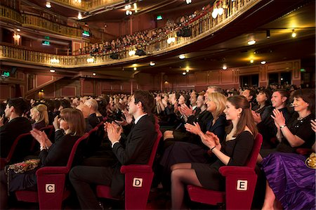 Audience applauding in theater Stock Photo - Premium Royalty-Free, Code: 6113-07542960