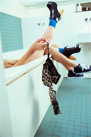 Couple removing woman's bra in bathtub Stock Photo - Premium Royalty-Free, Code: 6113-07542996
