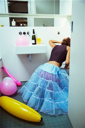 Woman vomiting into toilet at party Stock Photo - Premium Royalty-Free, Code: 6113-07542998