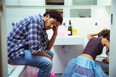 Drunk couple in bathroom at party Stock Photo - Premium Royalty-Free, Code: 6113-07542999