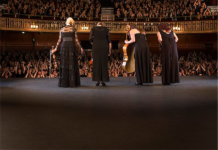 Quartet bowing on stage in theater Stock Photo - Premium Royalty-Free, Code: 6113-07542914