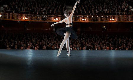 Ballerina performing on stage in theater Stock Photo - Premium Royalty-Free, Code: 6113-07542923