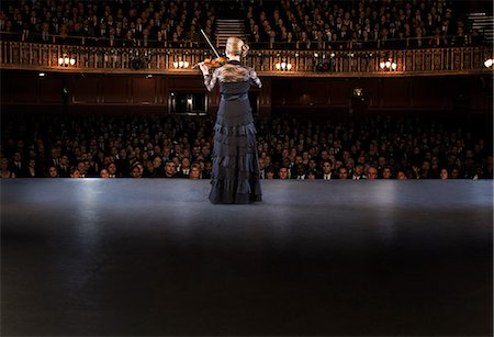 Violinist performing on stage in theater Stock Photo - Premium Royalty-Free, Code: 6113-07542922