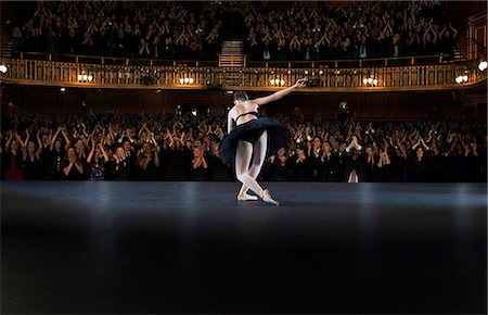 Ballerina  bowing on stage in theater Stock Photo - Premium Royalty-Free, Code: 6113-07542925