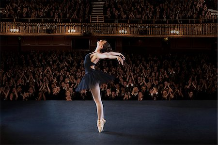 Ballerina performing on stage in theater Stock Photo - Premium Royalty-Free, Code: 6113-07542929