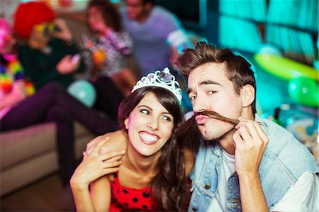 funny pose - Smiling couple playing together at party Stock Photo - Premium Royalty-Free, Code: 6113-07543051
