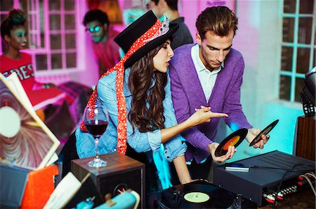party - Couple playing records at party Stock Photo - Premium Royalty-Free, Code: 6113-07543074