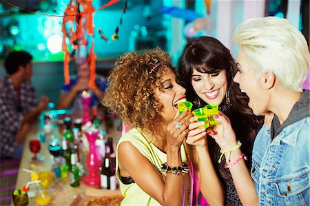 Women taking shots at party Stock Photo - Premium Royalty-Free, Code: 6113-07543017