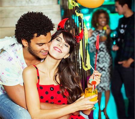 Man hugging girlfriend at party Stock Photo - Premium Royalty-Free, Code: 6113-07543027
