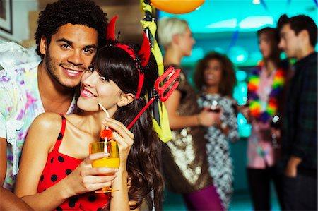 Man hugging girlfriend at party Stock Photo - Premium Royalty-Free, Code: 6113-07543028