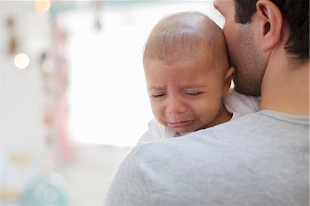 Father holding crying baby boy Stock Photo - Premium Royalty-Free, Code: 6113-07543165