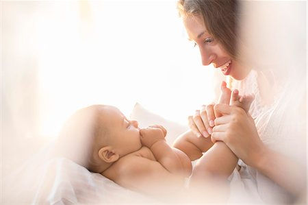 Mother playing with baby boy Stock Photo - Premium Royalty-Free, Code: 6113-07543197