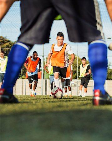 footballeur - Soccer players training on field Stock Photo - Premium Royalty-Free, Code: 6113-07543119