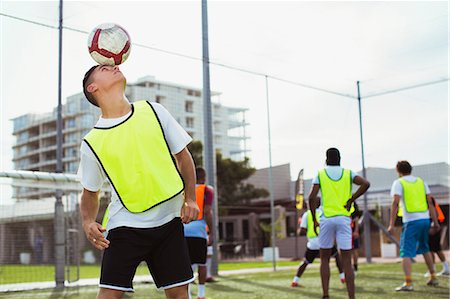 Soccer player training on field Stock Photo - Premium Royalty-Free, Code: 6113-07543123