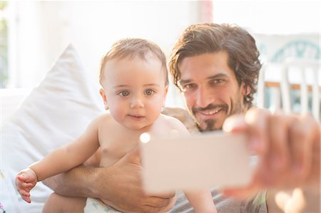 Father taking self-portrait with baby boy Stock Photo - Premium Royalty-Free, Code: 6113-07543243