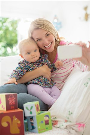 Mother taking self-portrait with baby girl Stock Photo - Premium Royalty-Free, Code: 6113-07543280