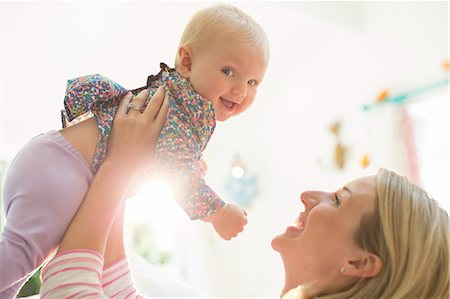 Mother playing with baby girl Stock Photo - Premium Royalty-Free, Code: 6113-07543232