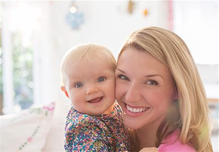 Mother holding baby girl Stock Photo - Premium Royalty-Free, Code: 6113-07543239