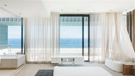 Modern bedroom overlooking ocean Stock Photo - Premium Royalty-Free, Code: 6113-07543360