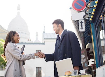 Business people shaking hands on city street Stock Photo - Premium Royalty-Free, Code: 6113-07543395