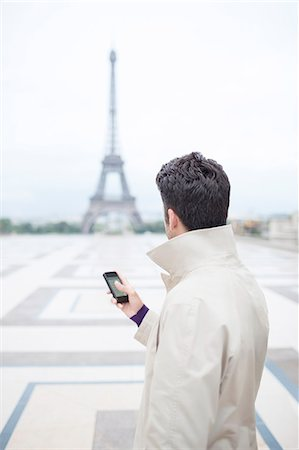 Businessman admiring Eiffel Tower, Paris, France Stock Photo - Premium Royalty-Free, Code: 6113-07543398