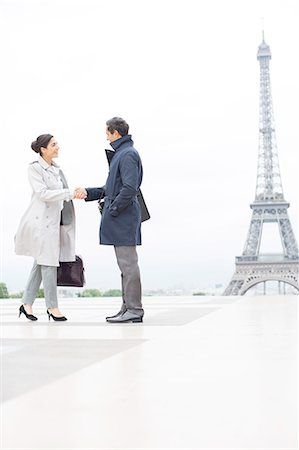 Business people shaking hands near Eiffel Tower, Paris, France Stock Photo - Premium Royalty-Free, Code: 6113-07543496