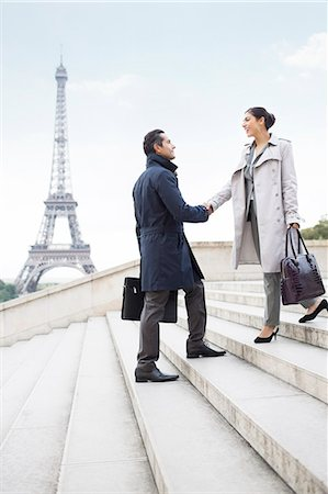 Business people shaking hands by Eiffel Tower, Paris, France Stock Photo - Premium Royalty-Free, Code: 6113-07543410