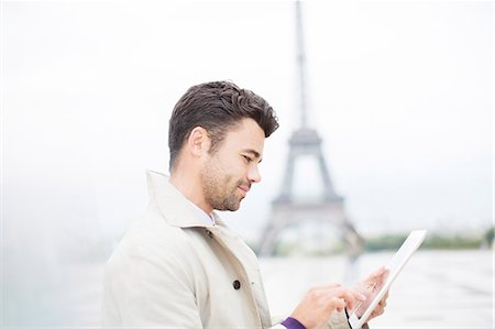 places - Businessman using digital tablet by Eiffel Tower, Paris, France Stock Photo - Premium Royalty-Free, Code: 6113-07543415